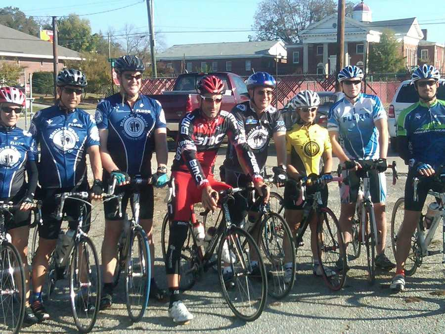 The cyclists pose with Hincapie before taking off.