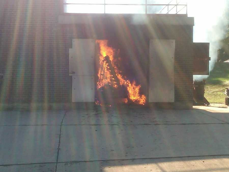 A fire is being built in the training structure at the Spartanburg County Emergency Services Academy.