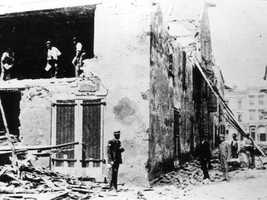 Men survey the damage done to a Charleston warehouse.
