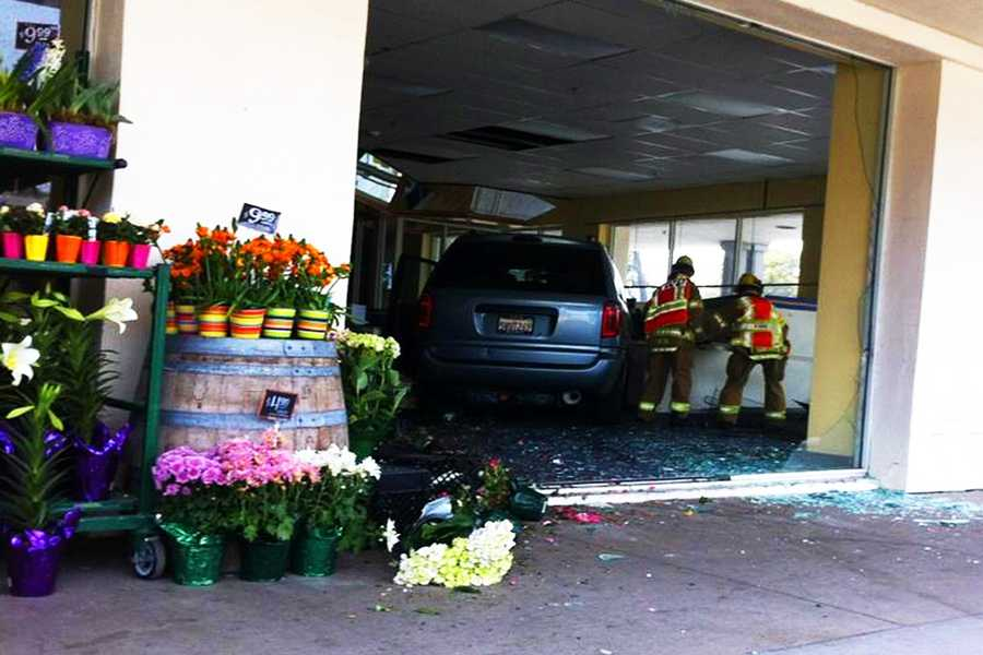 A car crashed into a Pacific Grove building and burst through a store next to Trader Joe's on April 3, 2012. The car shattered the building's front glass doors on Forest Avenue andlanded inside a former Blockbuster video rental store.Trader Joe's employees and shoppers said once they got over the shock of seeing a car smash through a building, the specialty grocery store went back to operating as usual.