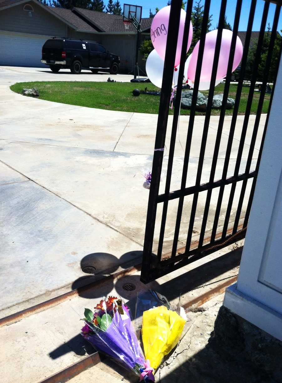 Balloons and flowers are seen on May 22 at Sierra Lamar's mother's house in Morgan Hill.