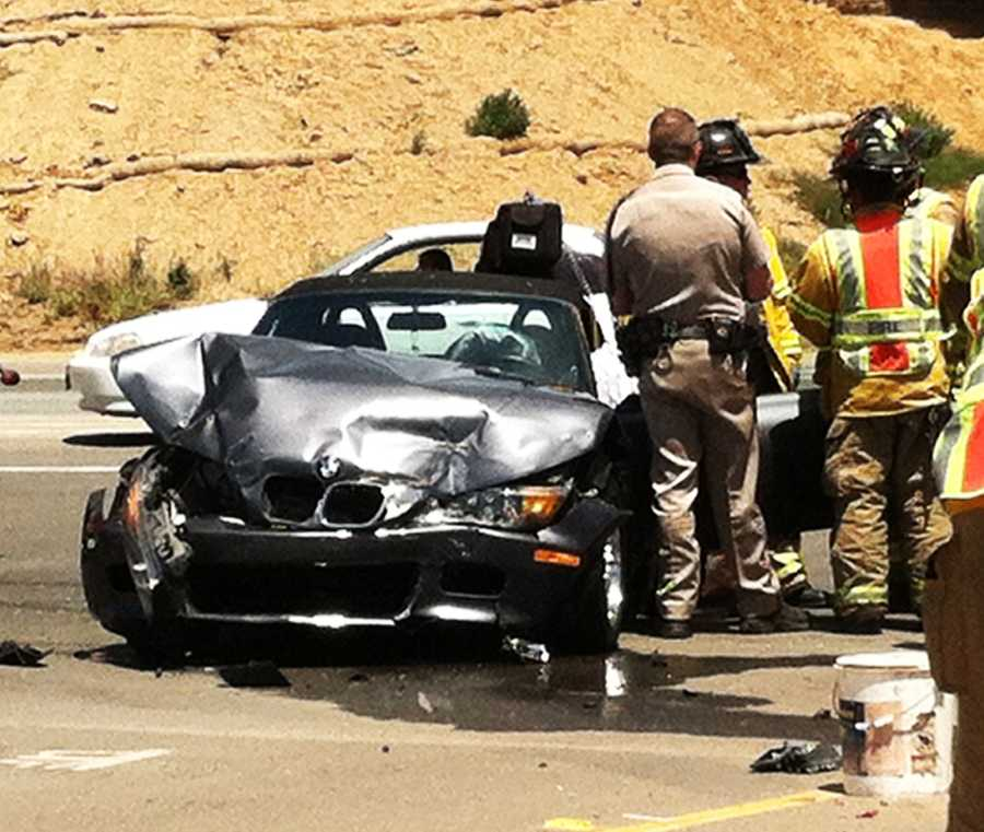A driver in a Honda attempted to make a left turn from Highway 101 onto Espinosa Road. The Honda smashed into a BMW and landed on its roof. A white Ford was also entangled into the collision and flipped. (June 15, 2012)