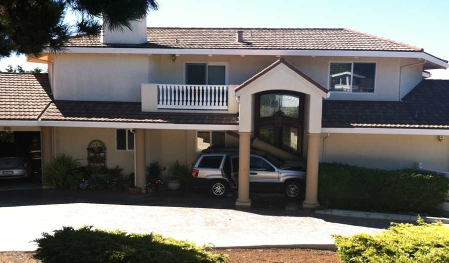The two-story house is located in an upscale neighborhood on Outlook Drive.The SVU caused major damage to the house's entryway and officials estimated to would take about $10,000 to fix it.(Aug. 28, 2012)