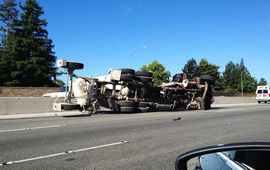 A concrete truck crashed into Highway 1's concrete center median near the Morrissey Exit.