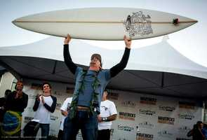 Peter Mel holds up his trophy after he is named the 2013 Mavericks Invitational champion.
