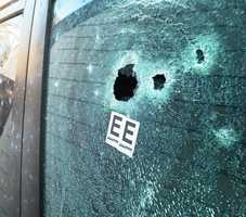 Bullet holes are seen on Doyle Street where Jeremy Goulet, 35, was shot and killed by Santa Cruz police officers and sheriff's deputies Tuesday.Goulet was firing at officers and was attempting to flee on foot when he was gunned down, Sheriff Phil Wowak said.