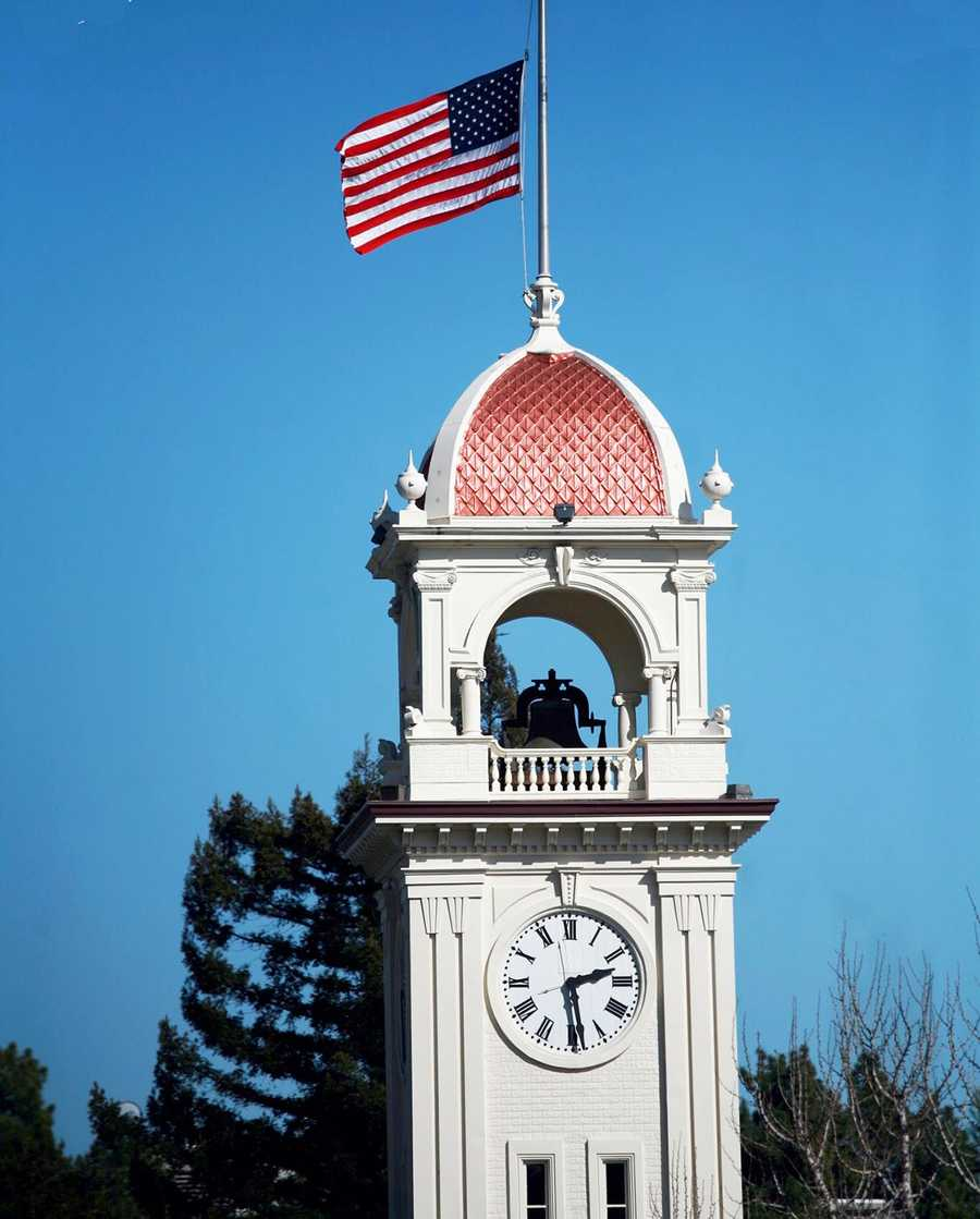 A U.S. flag was lowered on top of the Santa Cruz clock tower on Pacific Avenue to mourn the slain detectives. (Feb. 27, 2013)