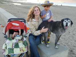 Santa Cruz Police Det. Elizabeth Butler is seen here with her baby, son, and dog. She is survived by her longtime partner, Peter, and two sons.