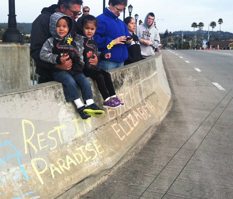 Children watch a solemn procession leave Santa Cruz.