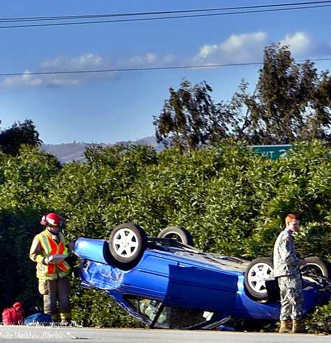 A driver in Greenfield escaped without injuries after flipping this blue car on April 6, 2013.