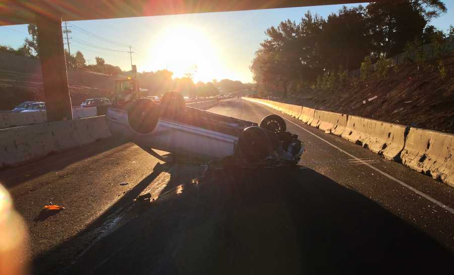 A woman flipped her car under the La Fonda Bridge in Santa Cruz on Sept. 16, 2013. She escaped with help from passing motorists.