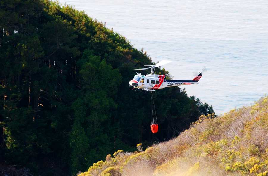 Fire crews continued an air attack Tuesday morning as helicopters and air tankers scooped water out of the ocean and from ponds before dumping it over burning trees in Los Padres National Forest.
