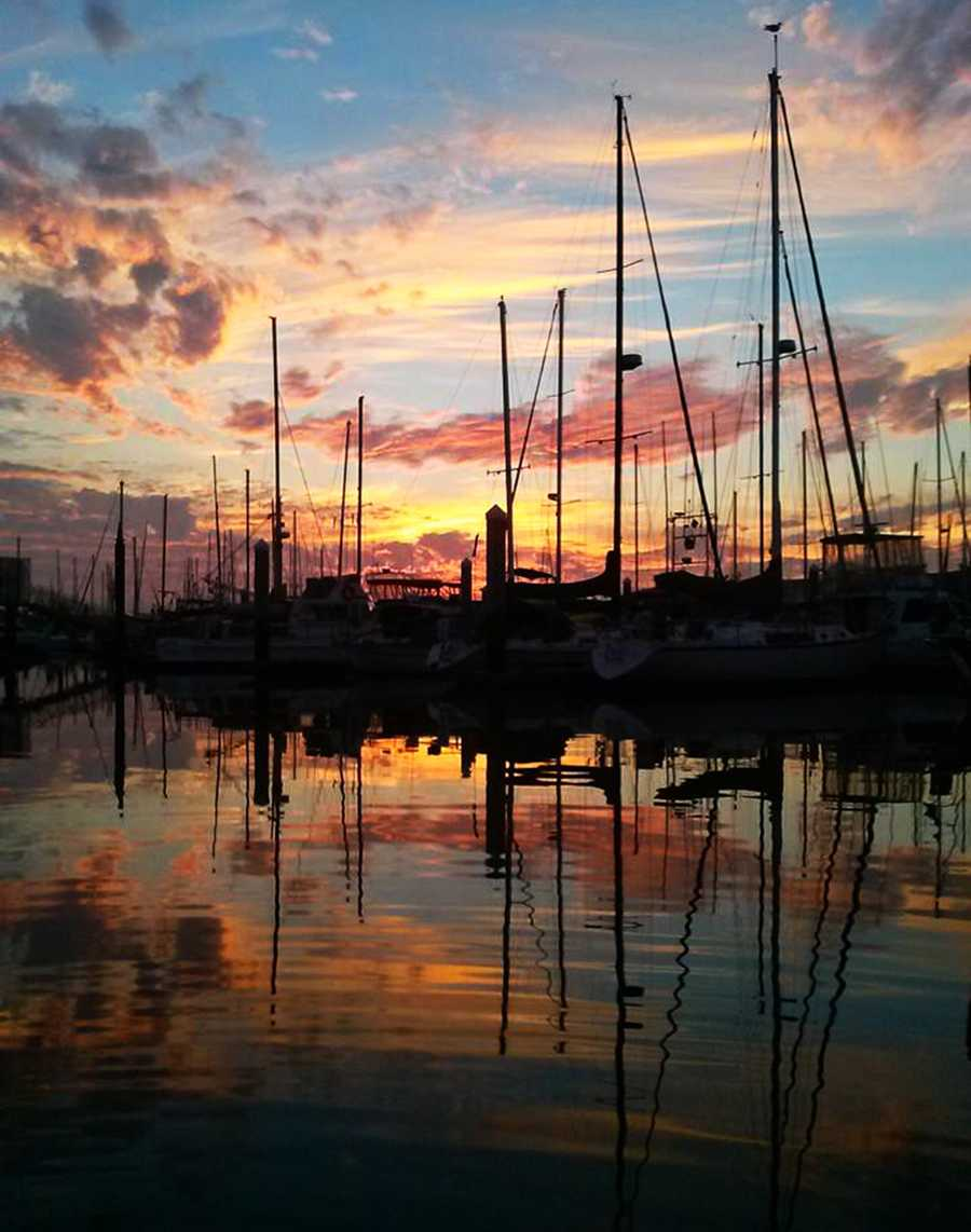Thick clouds of smoke from the Big Sur wildfire blew over Monterey, Salinas, and Santa Cruz and created a vivid sunset Tuesday. Nate Hydie shot this sunset photo in the Moss Landing Harbor.