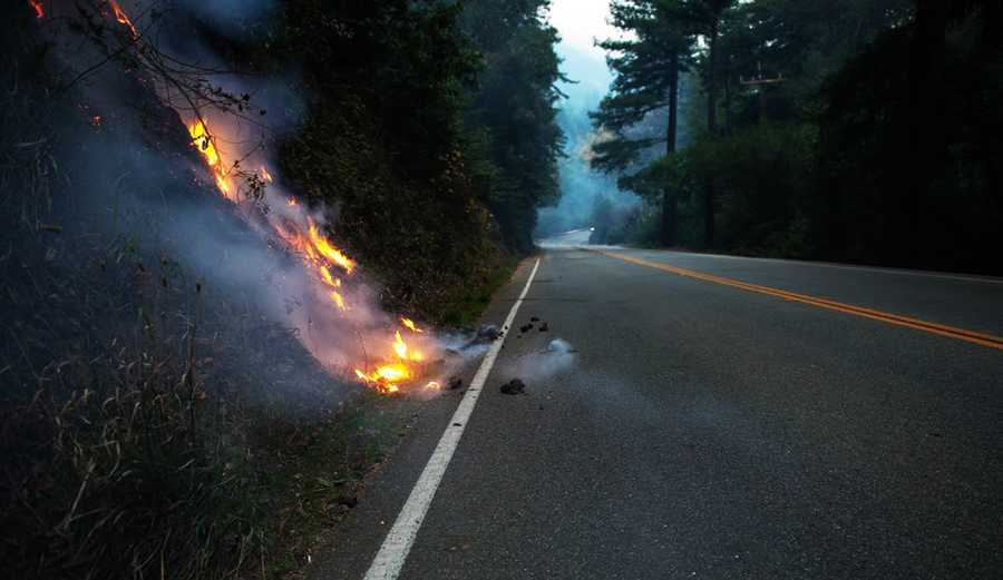 Fire embers fall onto Highway 1 in Big Sur.  /  Photo by George Krieger