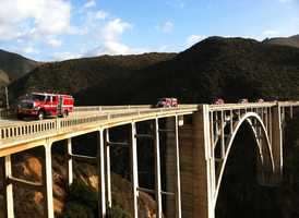 Firefighters are seen leaving Big Sur over the Bixby Bridge after almost fully containing the Pfeiffer Fire in December 2013.