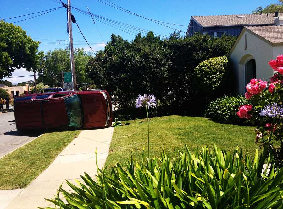 On May 6, 2014, a red sport utility vehicle crashed into a car and pickup truck that were parked on Pajaro Street. The SUV's front wheel flew off and the vehicle careened out of control past rose bushes before it flipped and landed on a front lawn.