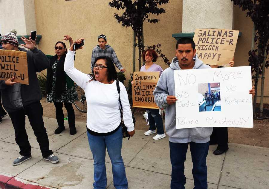 "MAY 21, 2014:  Demonstrators protested outside the Salinas police station, confronted detectives who were arriving and leaving, and yelled out ""murderers,"" and ""shame on you."""