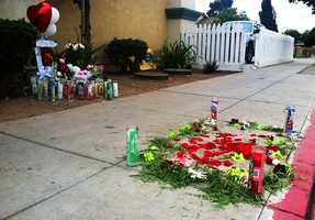 MAY 22, 2014:  A memorial of rose petals grew in East Salinas where Carlos Mejia was killed by police on Tuesday and two blocks from where an unknown gunman killed another man on Wednesday.