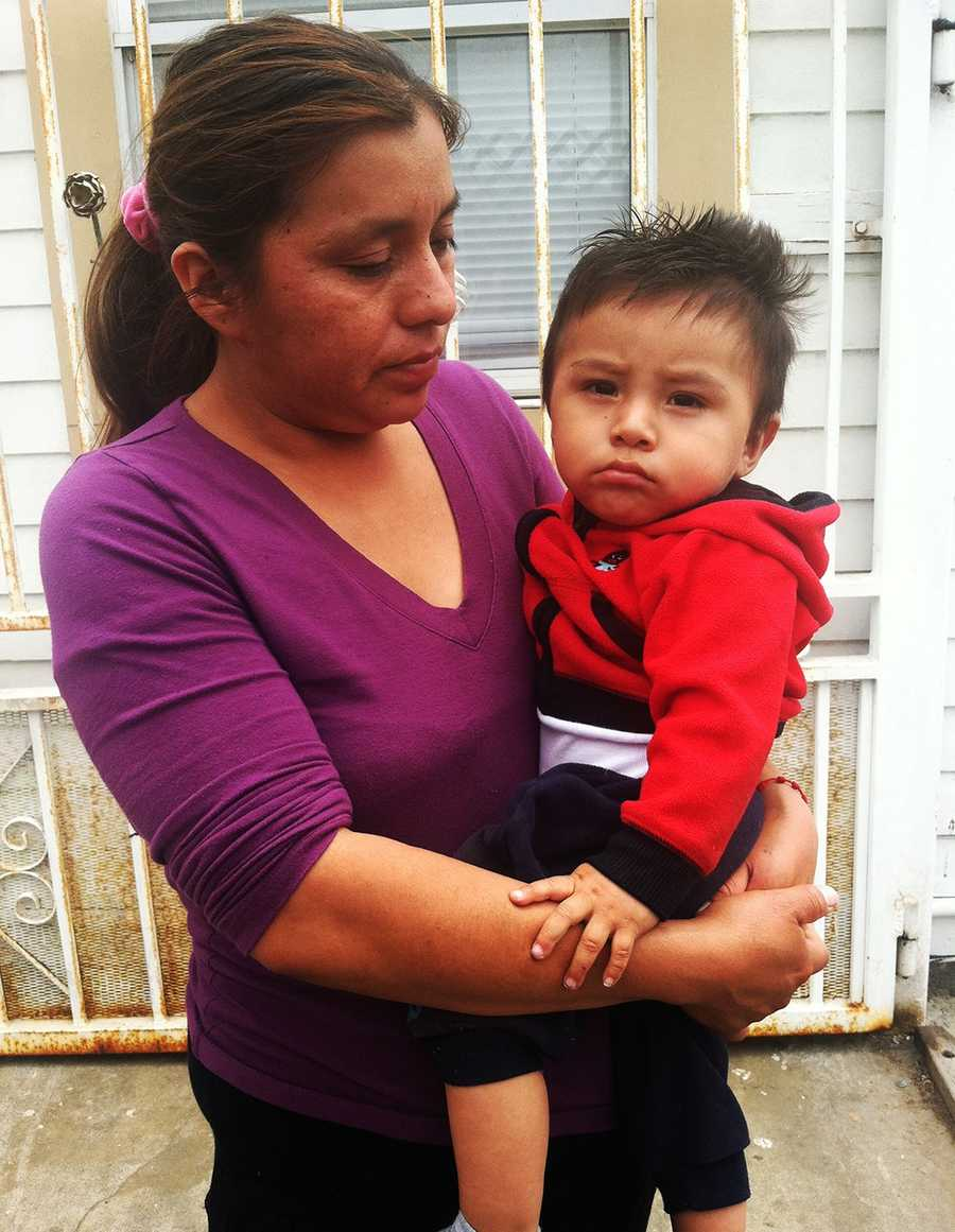 MAY 22, 2014:  Crying family members of Garcia said when he was not working, he always stayed home with his young son. Garcia's nephew is seen here. Garcia was a fieldworker who had recently moved to Salinas with his wife and child to pick strawberries during strawberry season.