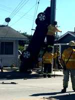 Police said the car went over a median, drove through a house's front yard fence, and flipped up against the power pole on East Bernal Drive and Natividad Road.  (Sept. 15, 2014)
