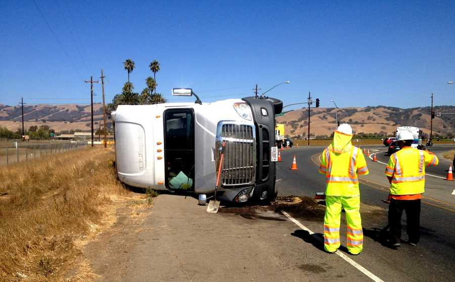 On Highway 152 between Gilroy and Hollister, a big-rig flipped and sparked a small brush fire. The trucker was hauling numerous cases of Budweiser beer. He suffered minor injuries. (Sept. 15, 2014)