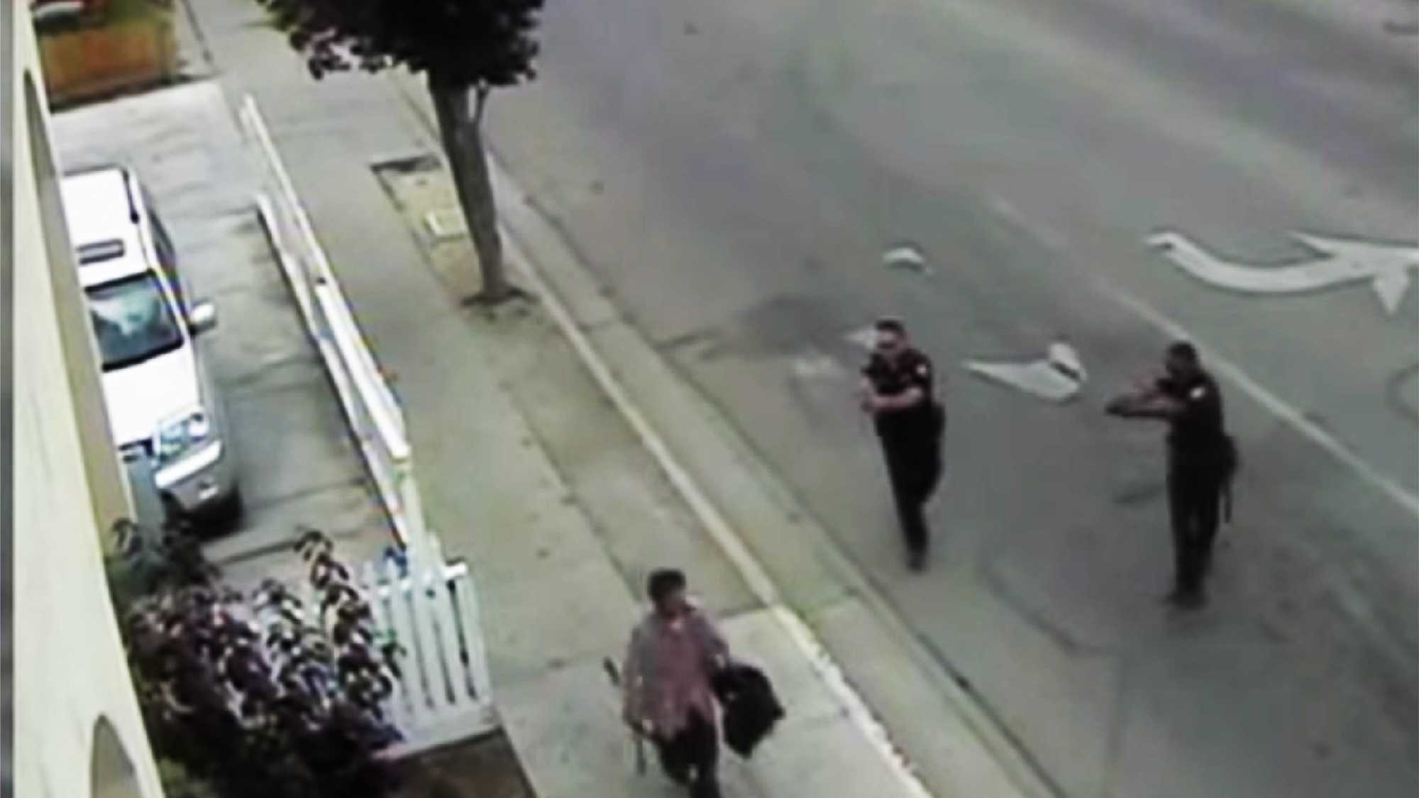 Carlos Mejia, left, is seen seconds before two officers, right, shot and killed him on May 20, 2014.