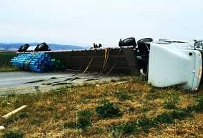 A big-rig carrying pipes rolled over on the northbound lanes of Highway 101 near the Airport Boulevard exit in Salinas. No injuries were reported in the May 2015 crash.
