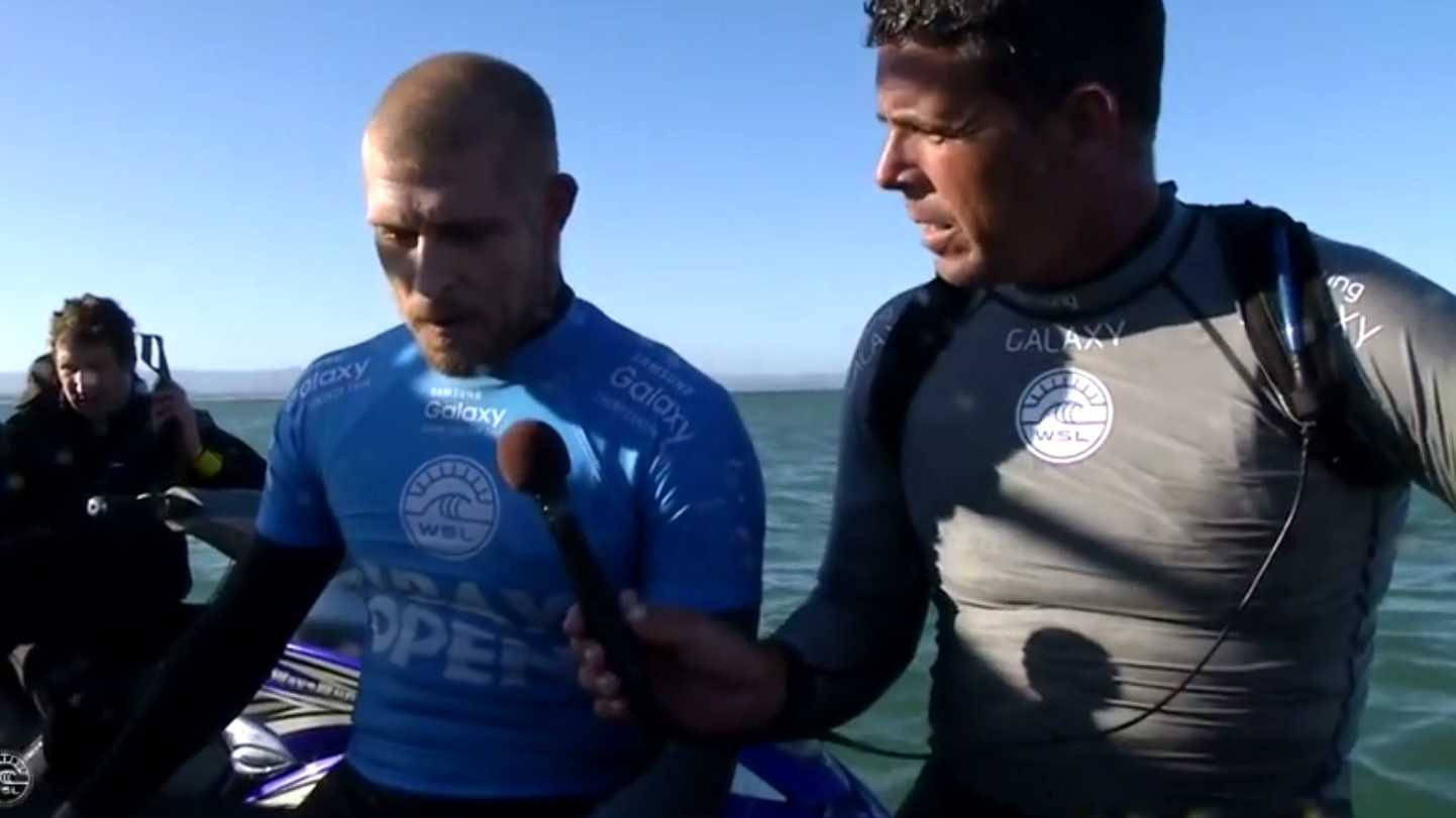 "Peter Mel of Santa Cruz, right, told a still stunned Mick Fanning, left, ""Buddy, you wrestled a shark."""