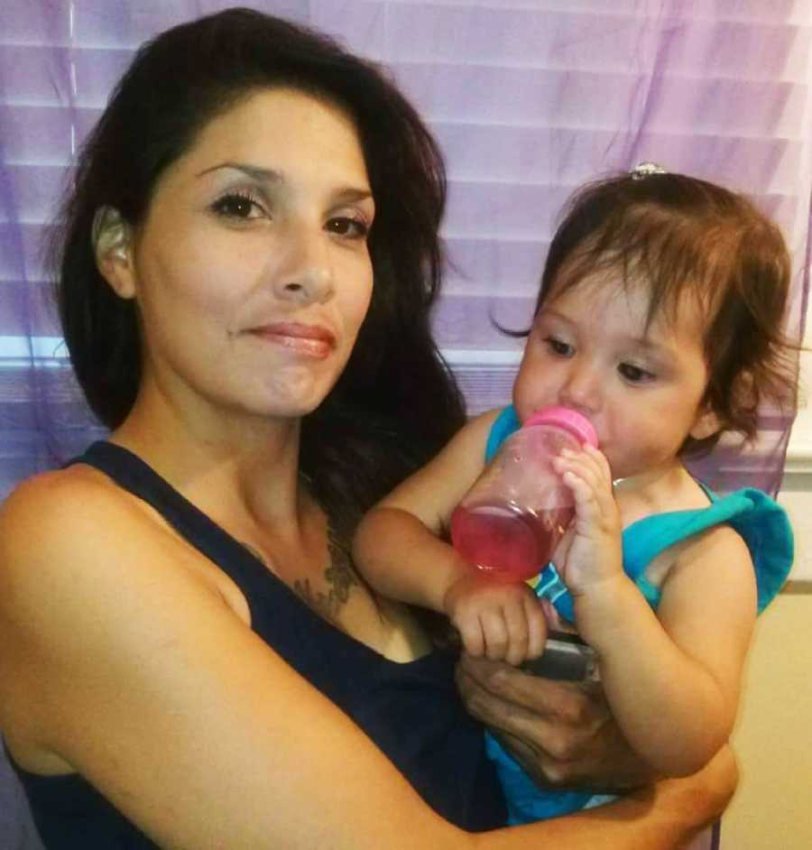 Friends said Huntsman was caring for the children because their mother (seen holding Delylah here) died after she was struck by a car while walking, and the father gave up custody.