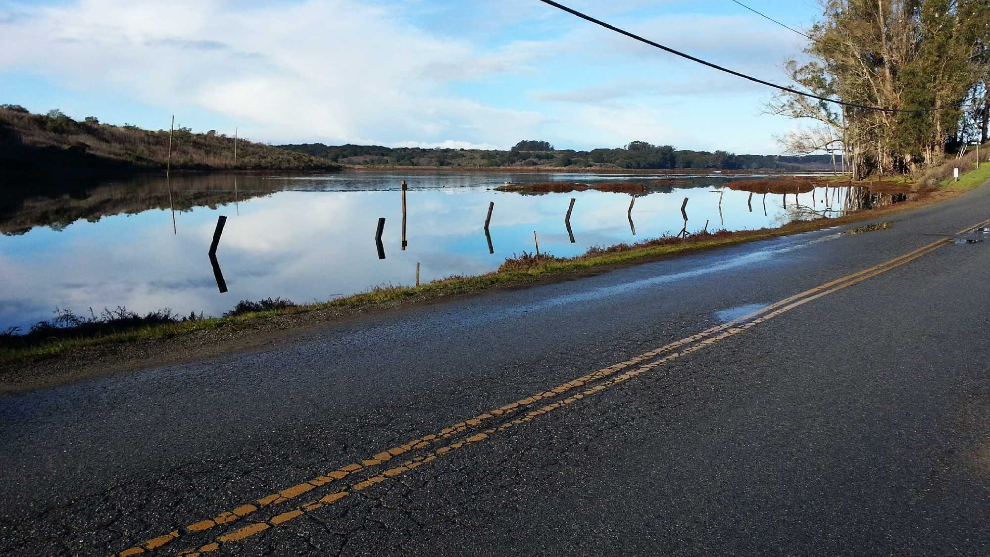 A road in Elkhorn Slough is a few inches away from being flooded.