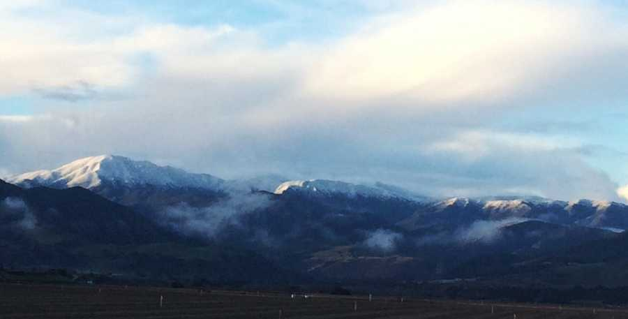Snow on top of Junipero Serra Peak is seen from Greenfield. (Jan. 7, 2016)