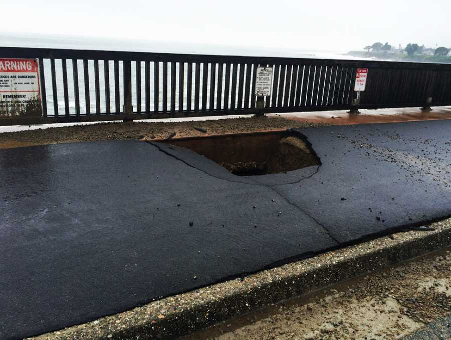 A sinkhole opened along West Cliff Drive in Santa Cruz because of battering waves.  (Jan. 29, 2016)
