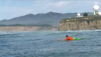 Nic Lamb paddling after catching a wave in the semifinal.