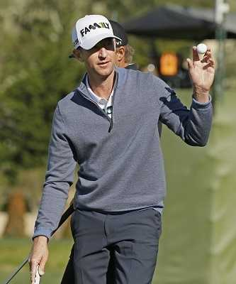 Vaughn Taylor holds up his ball after making a birdie putt on the second green of the Pebble Beach Golf Links during the final round of the AT&T Pebble Beach National Pro-Am golf tournament Sunday, Feb. 14, 2016, in Pebble Beach, Calif.