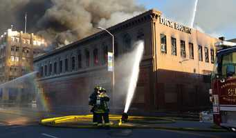 Embers were still smoldering Monday inside the Dick Bruhn building, two days after an inferno gutted the Oldtown Salinas landmark.