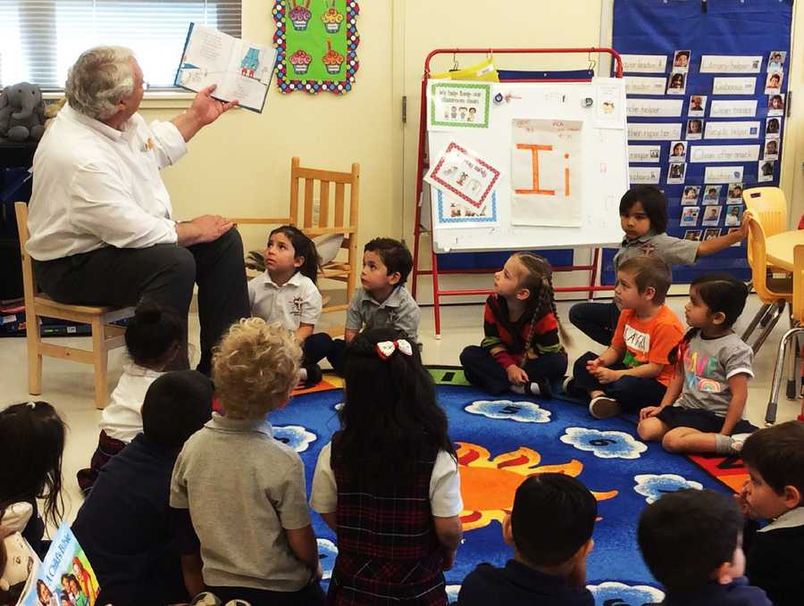 Former Salinas mayor Dennis Donohue read Dr. Seuss books to the students at Sacred Heart School in Salinas.