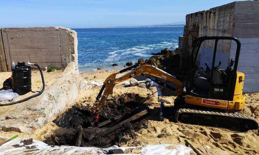 Oily sand was removed from McAbee Beach in Monterey along Cannery Row Tuesday.
