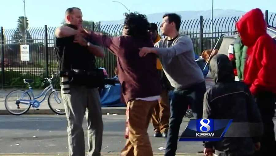 A Monterey Herald newspaper photographer was confronted by a violent protester.
