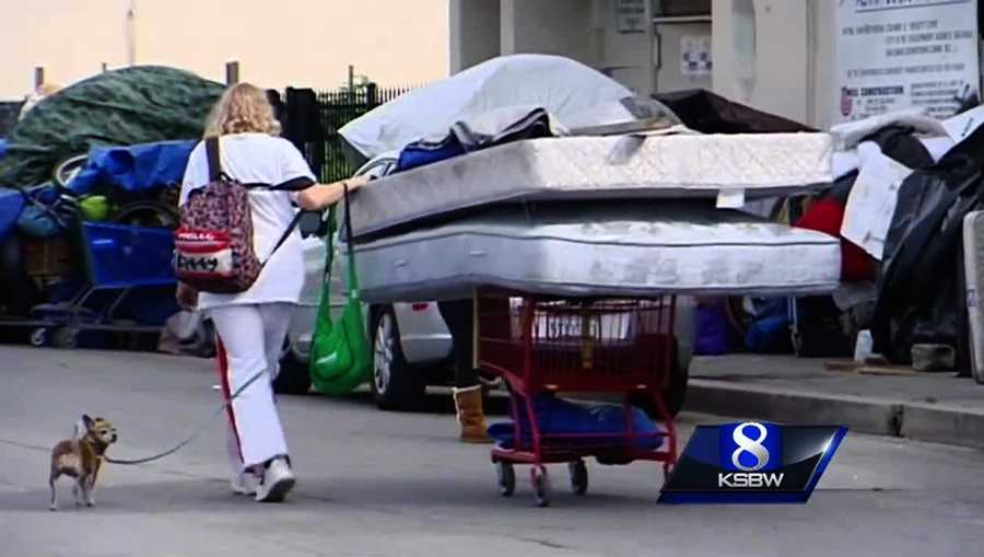 Salinas city cleanup crews attempted to sweep a sprawling homeless encampment in the Chinatown neighborhood on March 23. A woman is seen here moving her mattresses and pup.