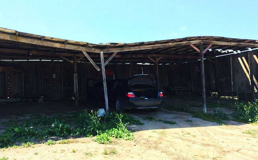 The car was found abandoned under this shed on a remote ranch between Chualar and Gonzalez.