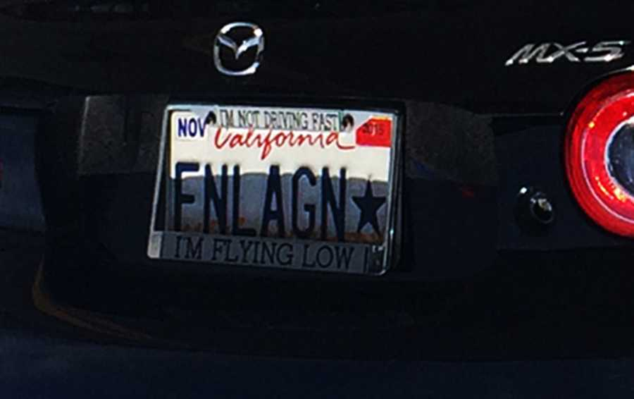 "The Mazda's personalized license plate frame read, ""I'M NOT DRIVING FAST, I'M FLYING LOW."""