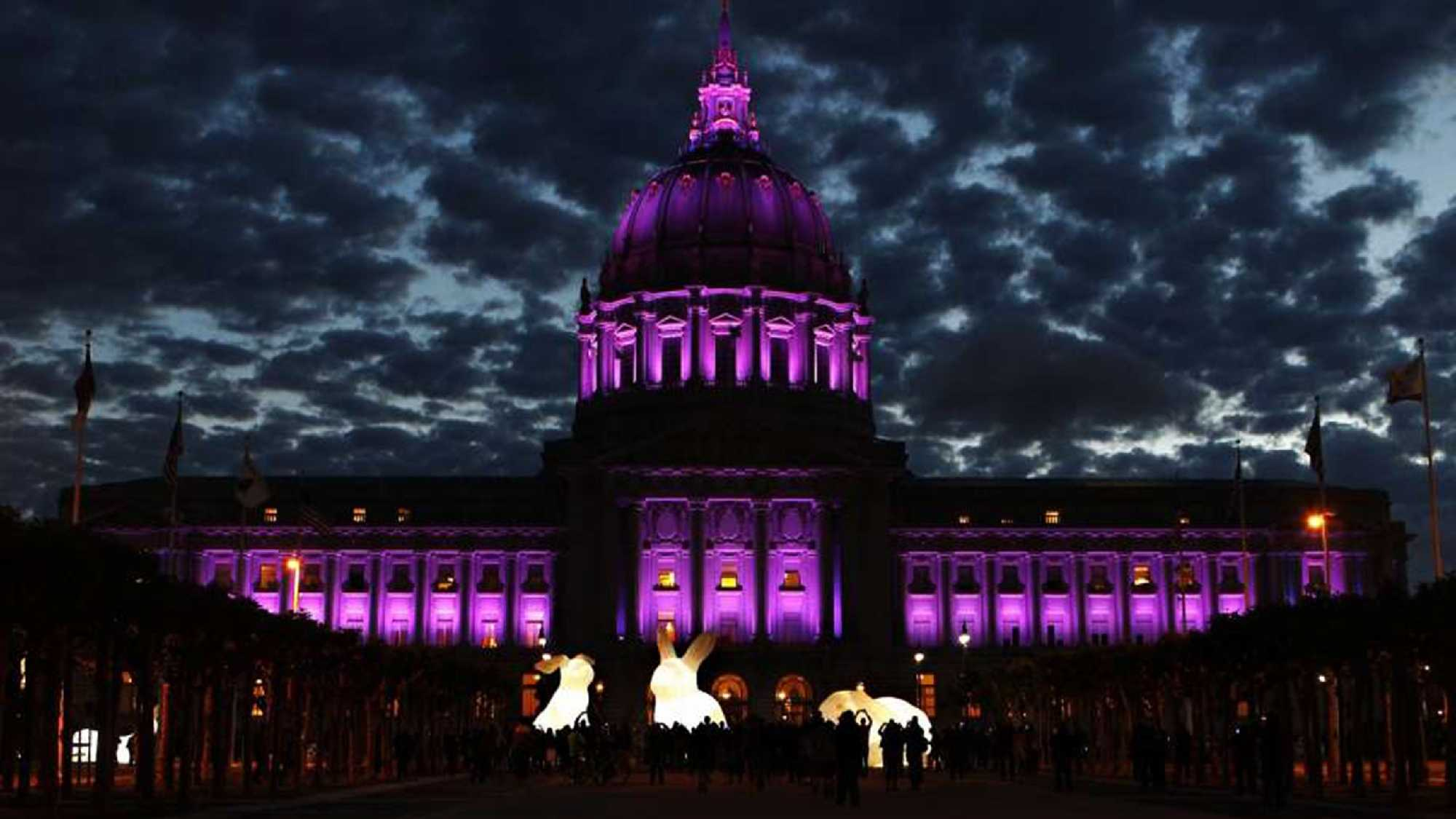 San Francisco pays tribute to the late musical artist Prince by lighting up City Hall in purple lights on Thursday, April 21, 2016.