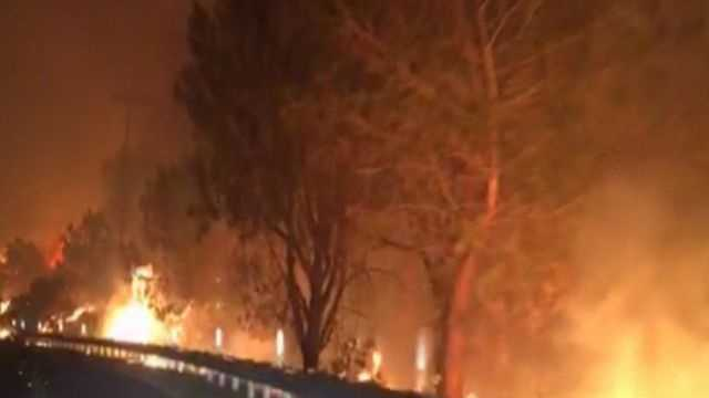 A fast moving wildfire in Central California has destroyed several dozen homes and continues to blaze.