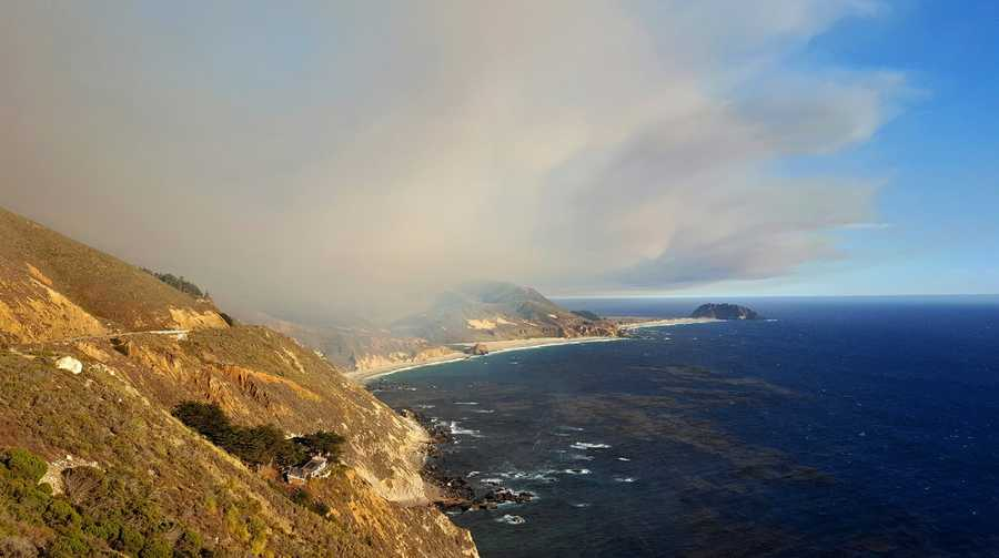 Smoke drifts above Big Sur's coastline.