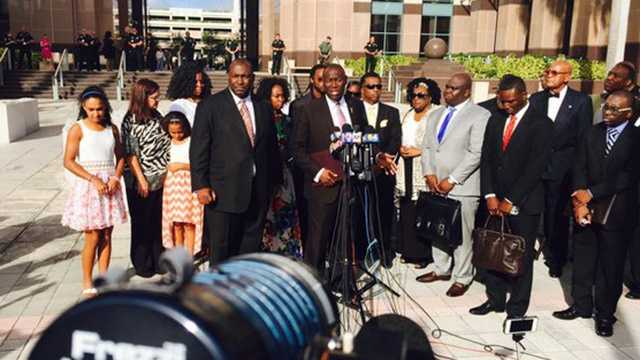 Oct. 22: Jones' family attorney Benjamin Crump addresses the media during a news conference in front of the Palm Beach County Courthouse.