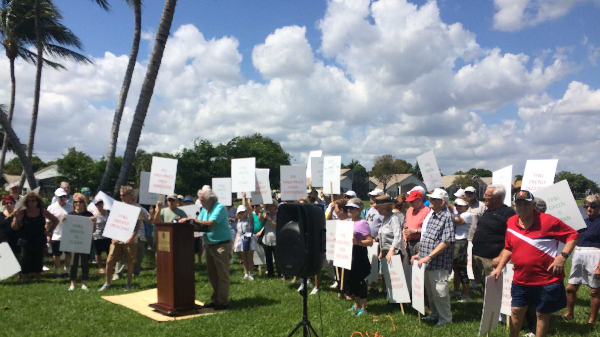 On the eve of Earth Day, about 250 homeowners gathered outside the Valencia Lakes neighborhood in Boynton Beach in an effort to challenge Florida Power and Light to switch its streets lights to energy efficient ones.