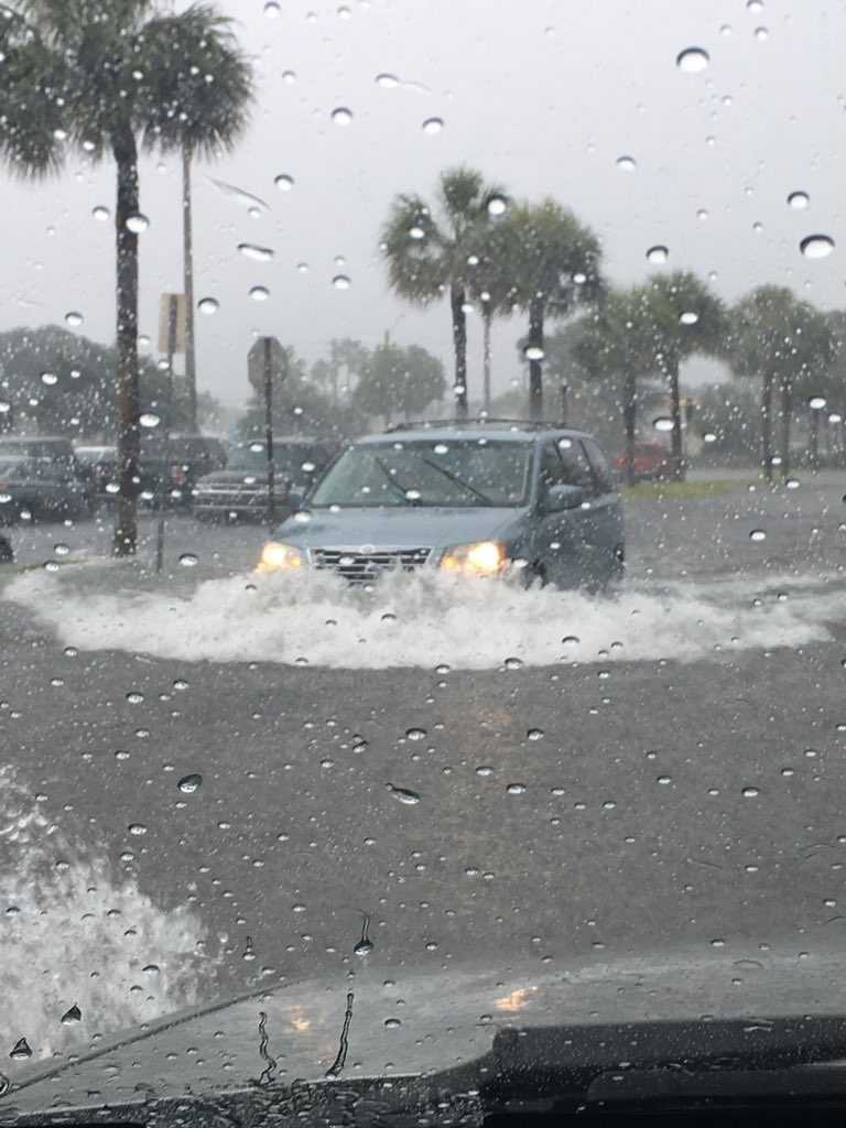 A car drives through the road during heavy rainfall. Photo courtesy of James Harp.