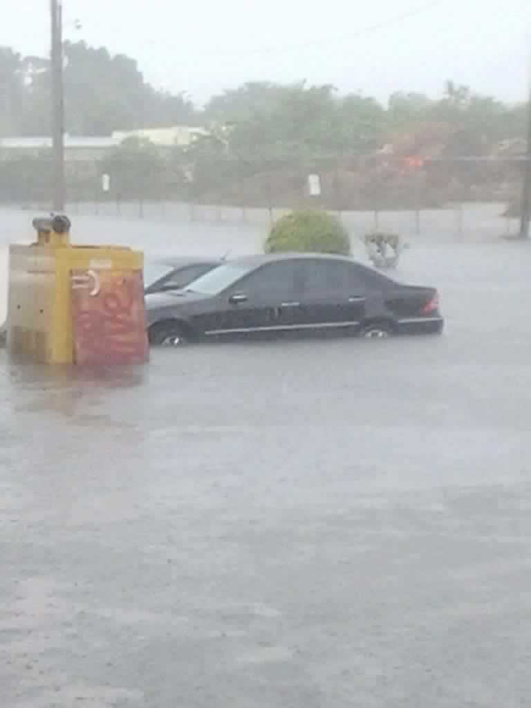 Severe flooding leaves a car trapped in a parking lot. Photo courtesy of Mandy Reece.