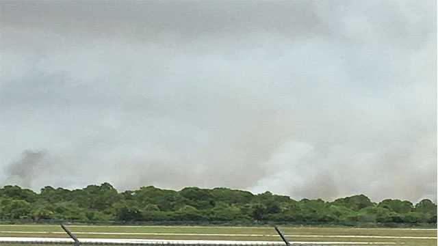 Firefighters rush to battle a brush fire reported Tuesday in Sebastian, Fla.