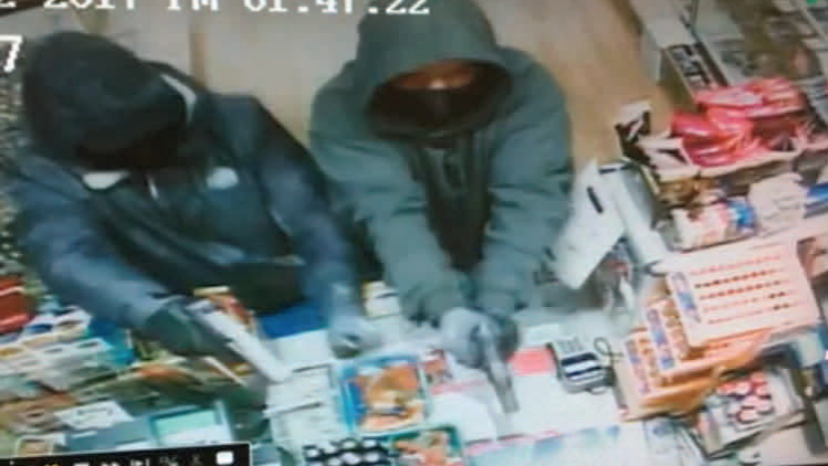 Two armed robbers were seen on surveillance video on Monday, Jan. 2, 2017, at a Grass Valley business, the Grass Valley Police Department said.